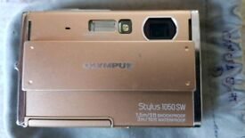 Olympus 1050SW with 2GB micro SD and charger