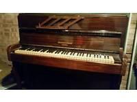 A nice small Monington and Weston piano