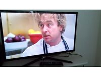 """Samsung 32"""" smart TV with swivel stand and remote control"""