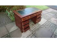A leather top traditional double pedestal desk