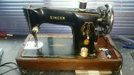 Singer sewing mashie with foot pedal and other accessories look picture's!Can deliver!