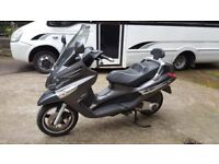 Piaggio xevo 250 2009 full years mot