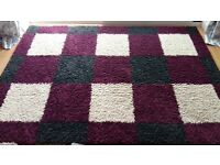 Large Rug, 225 by 160cm. Dark grey, purple and cream squares.
