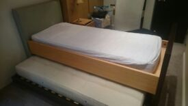 single bed with guest bed underneath (bespoke solid heavy bed)