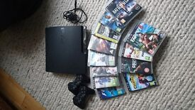 Playstation 3 (Slim), 2 Controllers & 12 Games