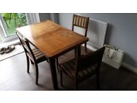 Vintage wooden extending dining table and 4 chairs