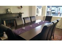Stunning looking dining table with 8 chairs and Sideboard