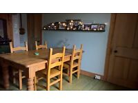 Solid pine rustic farmhouse kitchen table and 8 chairs.