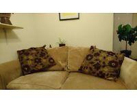 Large cream fabric three seater sofa