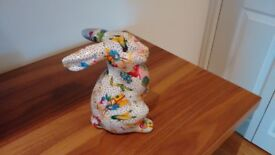 Ceramic decoupage rabbit figurine money box produced/made by Orchid.