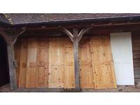 9 x Pine panel doors plus one plain fire door - good condition