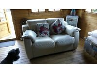 cream leather sofa bed, good condition, zip on arm is broken but can be easily sorted