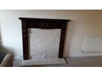 Marble fireplace with mahogany mantlepiece and electric fire