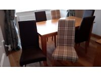 Solid light oak dining table with 6 chairs in excellent condition.