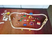 Wooden train set. battery engine, bridges, tunnel, houses, play park, carriages, people etc etc