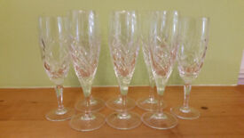 Set of 6 and pair of 2 cut glass champagne flutes