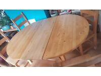 Pine wooden extendable dining table and 8 chairs