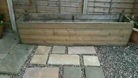 Large wooden decking planter