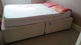 bed with mattress, duvet and some pillows