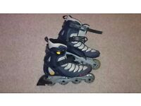 Genuine Rollerblades, Adult Size 9. Includes knee, elbow, wrist pads.
