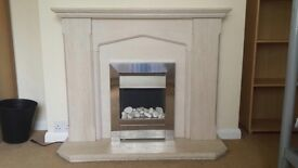 Stone fireplace with electric fire