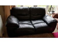 2 seater black leather sofa in excellent condition