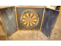 Winmau dart board in cabinet