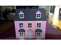 Dolls House with furniture and figures.