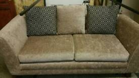 A brand new stylish good quality golden fabric 3 seated sofa .