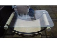 Roman cream coffee table with glass top for sale. must be uplifted themself. pick up asap.