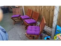 4 Wooden garden chairs excellent condition + brand new cushions. £100.00 ONO collection only