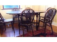 Solid Oak double leaf dining room table w/ 6 chairs
