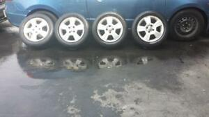 FORD FOCUS FACTORY 16 INCH RIMS IN GOOD CONDITION. THE TIRES MOUNTED ARE MICHELIN HIGH PERFORMANCE 205 / 55 / 16 TIRES