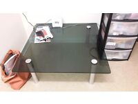 Glass coffee table in black with metal legs
