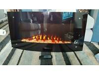 Wall hung electric fire with remote control