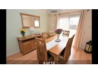 Real oak dining table and six chairs