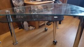 Two tier glass table in like new condition.