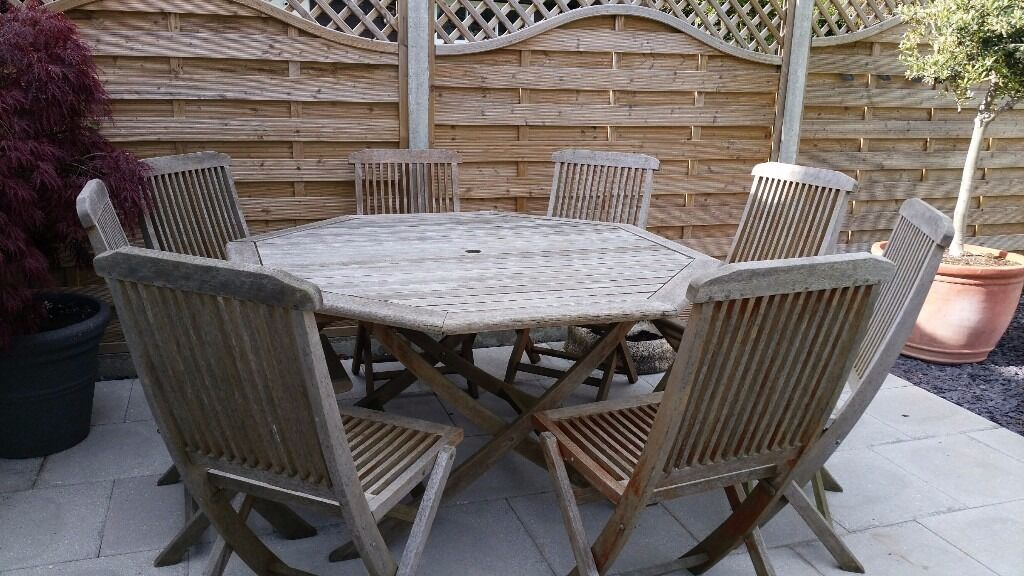 wooden octagonal garden table and 8 chairs provisionally sold