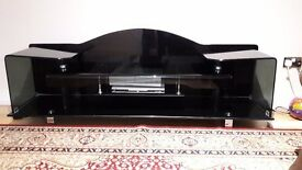 "TV UNIT, Smoke glass led tv unit for sale. hold upto 65"" led tv."