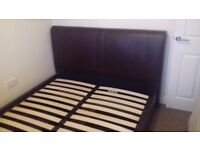 Brown leather king size bed base
