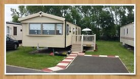 Deluxe Plus 3 bedroom Caravan at Seton Sands with decking on a child friendly pitch.