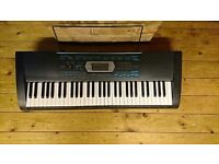 Casio CTK-2100 electric keyboard with attached music stand