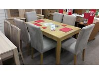 Light Wood Dining Table + 6 Light Brown Fabric Chairs