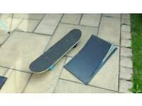 Nearly new skate board and ramp great Xmas present