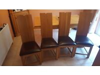 4 solid oak dining chairs with leather seating