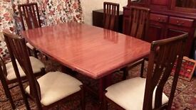 large mahogany table and chairs