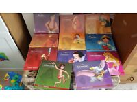 11 Disney DVDs and books in Spanish