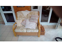 4 piece ratan suite. 2 armchairs, 2 seater sofa, coffee table