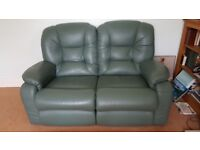 Green leather sofa and recliner chair,
