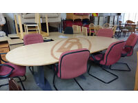 Large oval boardroom table with 6 red chairs (delivery available)